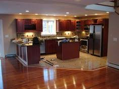 Kitchen Tiles Floor by Light Tile With A Seamless Transition To Dark Wood Floor Perfect