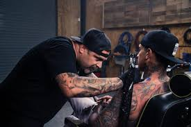 carey hart gets tattooed with ink from indian motorcycle