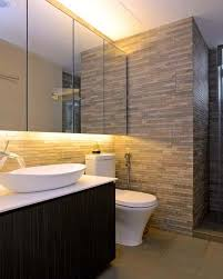 wide plain mirror gives larger effect for sleek small bathroom