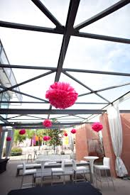 reception and cocktail set up on terrace with hanging decorations