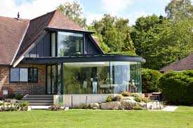 a dining room extension incorporating curved structural glazing a a dining room extension incorporating curved structural glazing a zinc roof and a frameless bay
