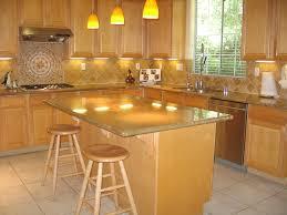 u shaped kitchen with maple cabinets and grey tile backsplash