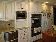 kitchen cabinet microwave built in image by cliqstudios cabinets kitchen pinterest traditional