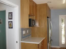 kitchen cabinets for microwave brown wooden kitchen cabinet with white granite gas stove