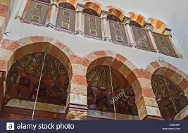 the carved wooden semidomes decorated with gilt ornaments in the