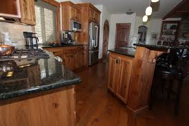 Rustic Hickory Kitchen Cabinets by Affordable Custom Cabinets Showroom