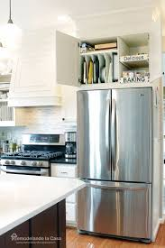 space between top of refrigerator and cabinet kitchen organization how to install pull out drawers in cabinet