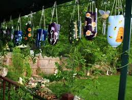 how to recycle plastic bottles for colorful handmade yard decorations