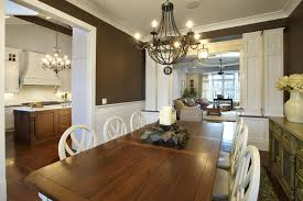 dining room farmhouse chandelier with wood dining table and white