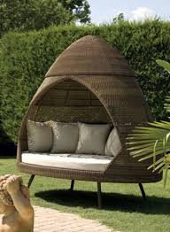 unusual patio furniture wicker canopy daybed round terra cotta