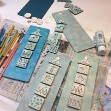 sue davis is painting mixed a clay tile assemblages