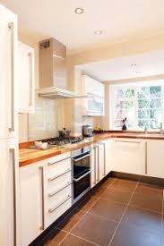 White Kitchen Cabinets With Tile Floor Modern White Kitchen With Wooden Worktops And Stainless Steel