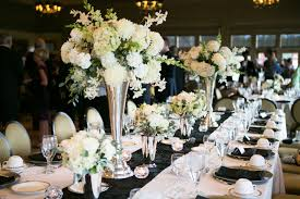white flower centerpieces white flower arrangement white and silver wedding table