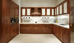 walnut kitchen cabinets with copper hood and under counter