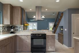 blue gray stained kitchen cabinets rustic coastal kitchen with gray stained cabinets quarts