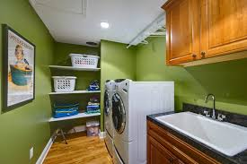 Vacuum Cleaner Storage Cabinet Portland Maine Laundry Baskets On Room Beach Style With Storage