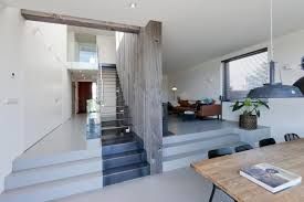 Modern Two Storey House With Streamline Roof by Serene Exterior Contrasts Highly To The Rough Inside Of This