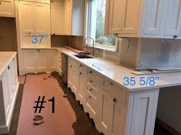 how to fix kitchen base cabinets to wall different height base cabinets wall cabs not