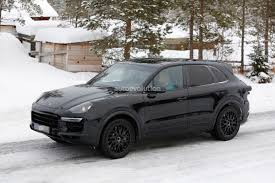 porsche suv blacked out 2018 porsche cayenne spied shows active rear spoiler autoevolution
