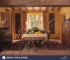 pile of citrus fruit and foliage on table in rustic spanish