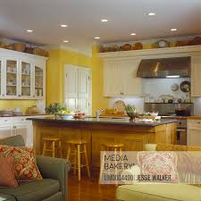 oak kitchen cabinets yellow walls photo by lived in images kitchens view from family room yellow walls custom made white cabinets wood floor food preparation island