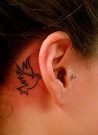 outline small dove tattoo behind the ear