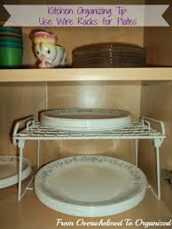Organize Cabinets In The Kitchen by Dishes And Glasses Cupboard Organizing Tips From Overwhelmed To