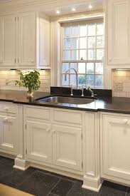 Love The Detail Around The Window And The Sconces Flanking It - Funky kitchen sinks