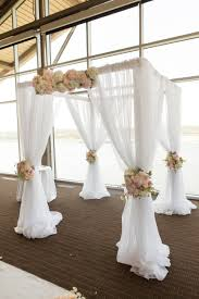 wedding ceremony canopy white draped canopy for indoor ceremony bouquets of