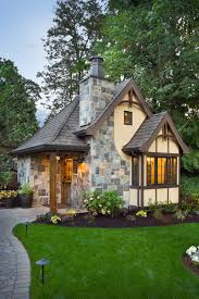 cottage design ideas exterior traditional with tudor style garden lighting gray roof