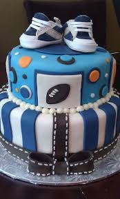 tier blue and white baby shower cake for boy with little sneakers