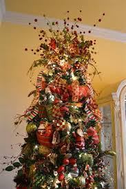 fun christmas tree decorating with colorful ribbons also decorate