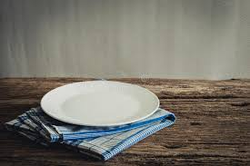 plate table top white plate on a napkin on wooden tabletop stock image image of