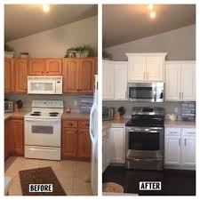 how to add crown moulding to cabinets before and after kitchen added crown molding new taller