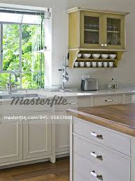 wall hung kitchen cabinets wall mounted kitchen cabinet next to sink at window ramhash