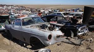 car yard junkyard ancient high plains wrecking yard packed full of detroit treasures