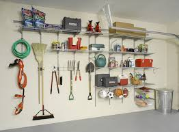 Garage Wall Shelves turn a garage wall into an organized center for tools gardening