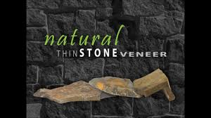 stucco home exterior transformed to stone using thin stone veneer