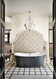 bathrooms mediterranean bathroom with vintage bathtub and tiles