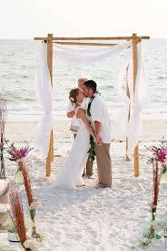 bamboo wedding arch white fabric draped bamboo wedding arch