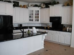 granite countertop white kitchen cabinets with oil rubbed bronze