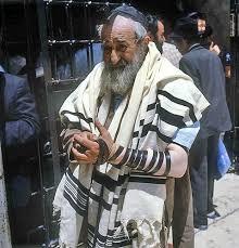 prayer shawls from israel jerusalem ashkenazi winding the tefillin bands and wearing the