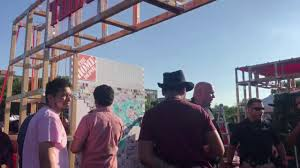 Home Depot Anti Trump Protesters Try Knocking Down Home Depot Sponsored Wall