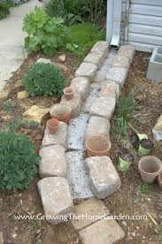 making a dry creek bed drainage canal for downspouts growing the