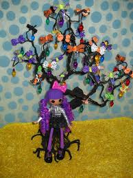 lalaloopsy doll with black wire tree decorated with hair