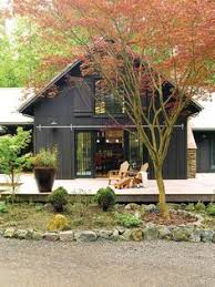 Houses With Big Porches Wrap Around Porch With Corrugated Metal Roof That U0027s The Look