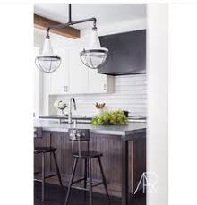 cuisiner light mirrored gold kitchen panel to increase light in room