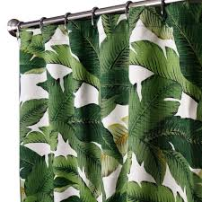 white fabric curtain with dark green leaves on stainless steel