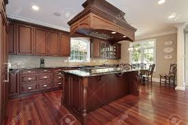 kitchen in luxury home with island stove stock photo picture and