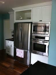 how to trim cabinet above refrigerator kitchen reface depot yelp kitchen refacing refrigerator